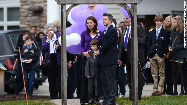 Parents attend the funeral of Dylan Hockley, 6, a victim of the Sandy Hook Elementary School shooting, on December 21 in Newtown, Connecticut.