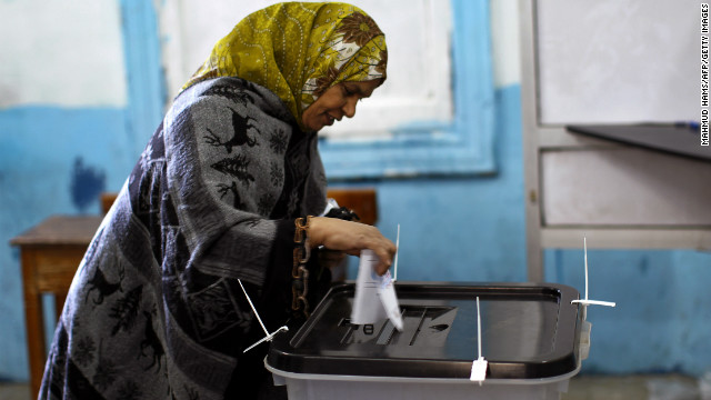 An Egyptian woman casts her ballot south of Cairo, on December 22.