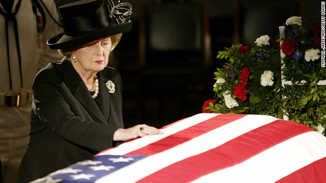 Thatcher touches the flag-draped coffin of Reagan as he lies in state in the U.S. Capitol Rotunda in June 2004. In a prerecorded video at his funeral, she called Reagan &quot;a great president, a great American and a great man.&quot; &quot;And I have lost a dear friend,&quot; she said.