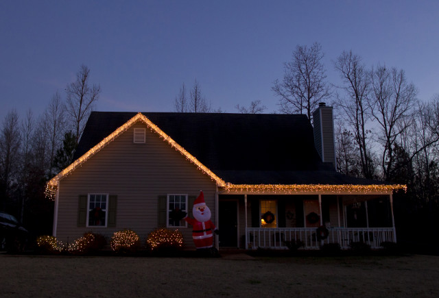 Christmas lights decorate the house recently bought by Sabrina and Tyler Evans.
