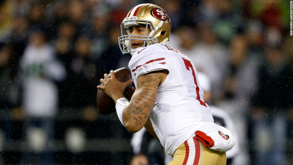 Colin Kaepernick of the San Francisco 49ers looks to pass against the Seattle Seahawks at Qwest Field on Sunday, December 23, in Seattle. Check out the action from Week 16 of the NFL and then<a href='http://www.cnn.com/2012/12/13/worldsport/gallery/nfl-week-15/index.html' target='_blank'> look back at the best photos from Week 15</a>.