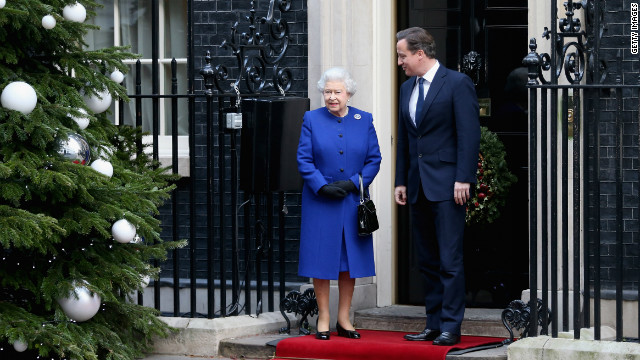 The queen is greeted by Prime Minister David Cameron as she arrives at Number 10 Downing Street to attend the Government's weekly Cabinet meeting on December 18, 2012. It was a historic occasion because it is thought to mark the first time a monarch has attended such a session since Queen Victoria more than a century ago.