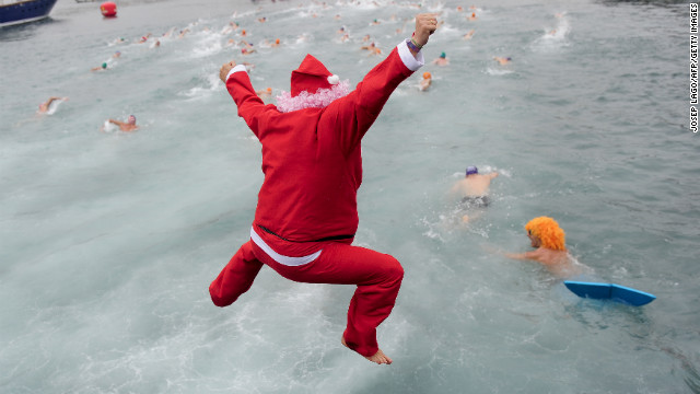 The cold water of Barcelona's Port Vell doesn't deter this swimmer dressed up as St. Nick from joining in the Copa Nadal swimming race, a traditional holiday event in the Spanish seaport, on Tuesday, December 25.