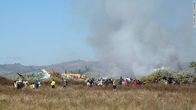 Smoke rises from the scene. The Air Bagan plane was trying to land at Heho Airport but was hampered by heavy fog, the Myanmar Ministry of Information said.