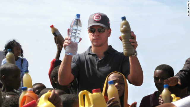 Actor Matt Damon hands out clean drinking water to children in Ethiopia. Damon helped found water.org in 2009.