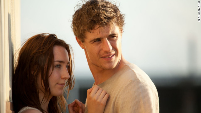 Saoirse Ronan and Max Irons star as Melanie Stryder and Jared Howe, respectively, in &quot;The Host,&quot; which is due out on March 29. The film adaptation of Stephenie Meyer's sci-fi novel is about parasitic aliens called Souls who invade Earth and possess human minds. When Melanie becomes inhabited by a Soul named Wanderer, they set out in search of Howe.