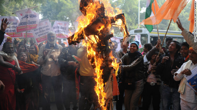 Indian demonstrators burn an effigy representing rapists during a protest in New Delhi on December 26, 2012.