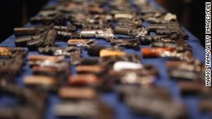 Illegal firearms confiscated in a weapons bust in New York\'s East Harlem is on display at an October news conference.