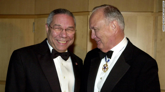 U.S. Secretary of State Colin Powell talks with Schwarzkopf on December 6, 2002, during a receptionbefore the American Patriot Award Dinner in Washington. The dinner honored former U.S. President George H. W. Bush.