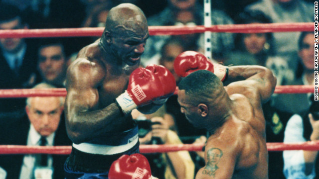 Holyfield knocks down archrival Mike Tyson.