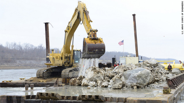 An excavator removes rocks from the bed of the Mississippi River near Thebes, Illinois.