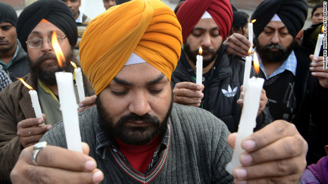 Indian residents hold lighted candles during a rally in Amritsar on December 29.