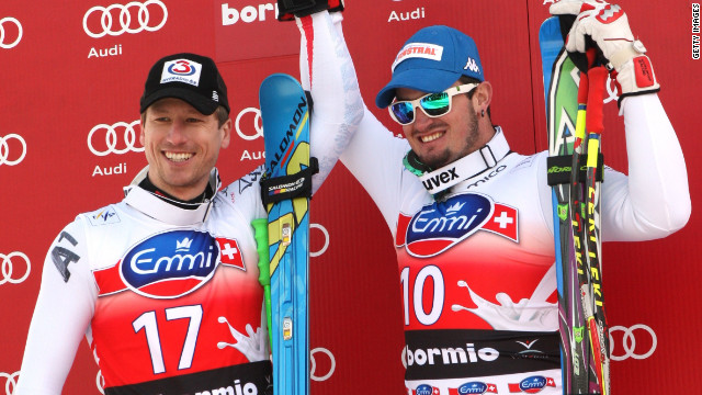 Dominik Paris, right, and Hannes Reichelt shared victory after finishing in a dead heat in the World Cup downhill at Bormio, Italy.