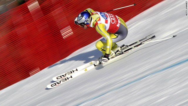 Aksel Lund Svindal extended his lead in both the downhill and overall standings as he finished third -- just 0.01 seconds behind leading duo.