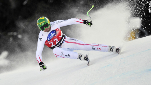 The Norwegian was just 0.01 seconds ahead of fourth-placed Austrian Klaus Kroll, who won the downhill title last season.
