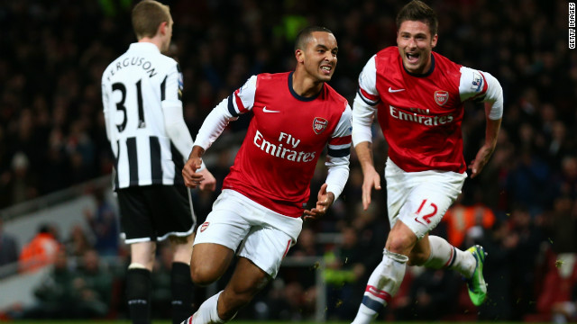 Theo Walcott (C) scored a hat-trick to inspire fifth-placed Arsenal to a 7-3 home win against Newcastle, while substitute Olivier Giroud (R) also netted twice. 