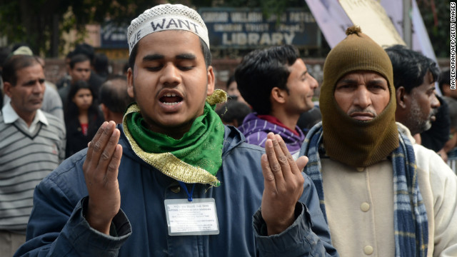 Indian residents pray during a gathering in New Delhi on December 30.