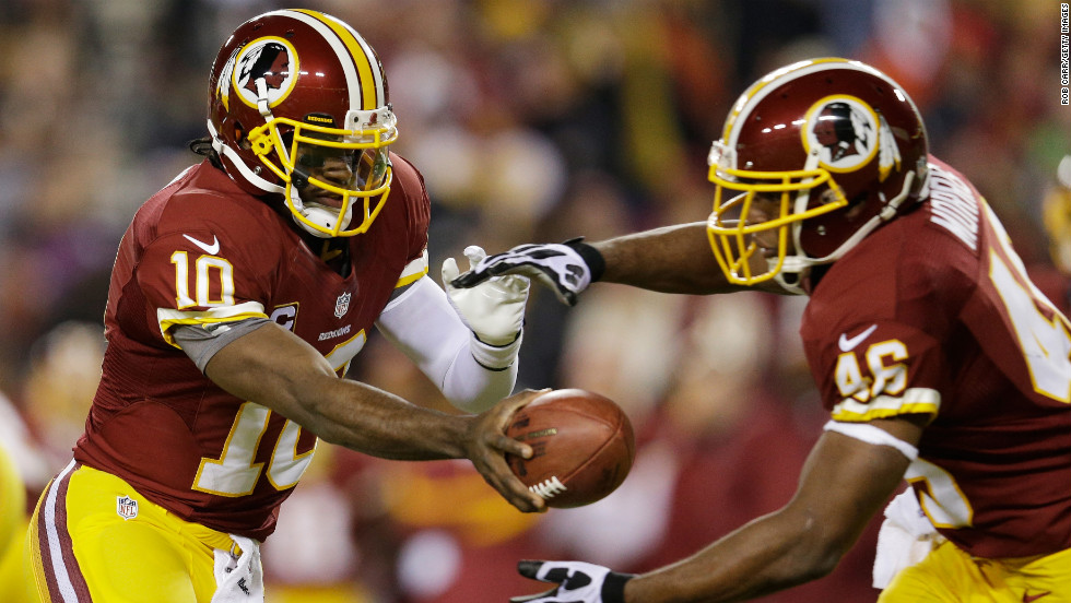 Quarterback Robert Griffin III of the Washington Redskins hands off to Alfred Morris during the game against the Dallas Cowboys on Sunday, December 30, at FedEx Field in Landover, Maryland. Check out the action from Week 17 of the NFL and then &lt;a href='http://www.cnn.com/2012/12/22/worldsport/gallery/nfl-week-16/index.html'&gt;look back at the best photos from Week 16&lt;/a&gt;.