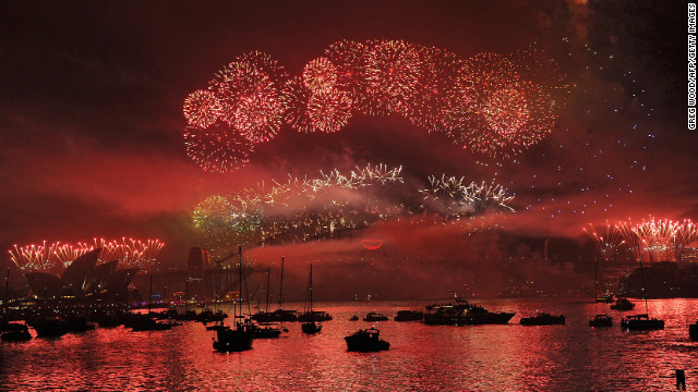Boats dot Sydney Harbour as New Year's Eve fireworks erupt over the Sydney Harbour Bridge.