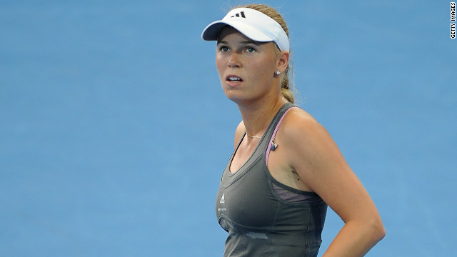 Caroline Wozniacki slips to defeat against qualifier Ksenia Pervak in the first round of the Brisbane International.