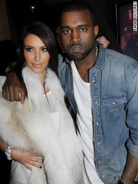 "In March, a month <a href='http://marquee.blogs.cnn.com/2012/04/05/kanye-admits-he-fell-in-love-with-kim-k-in-song/' target='_blank'>before Kanye told the world he ""fell in love with Kim"" in a new song</a>, the pair were seen embracing at his Fall/Winter 2012 fashion show in Paris."