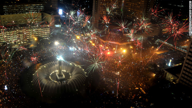 Fireworks are launched over Jakarta's main business road to mark the new year in Jakarta, Indonesia.