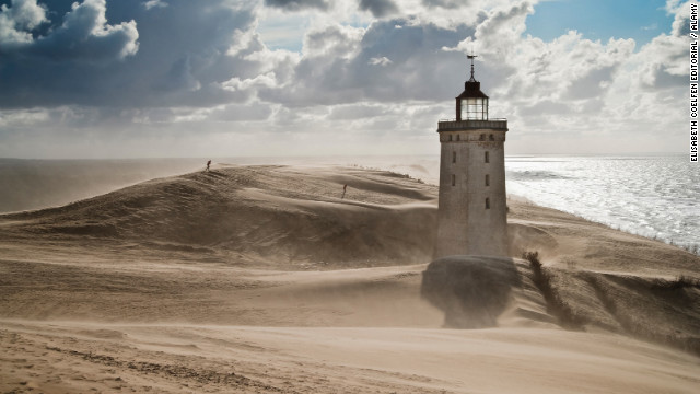 The Rubjerg Knude lighthouse in Hjørring, Denmark. this ghostly sentinel was built in 1900 but abandoned in 1968.