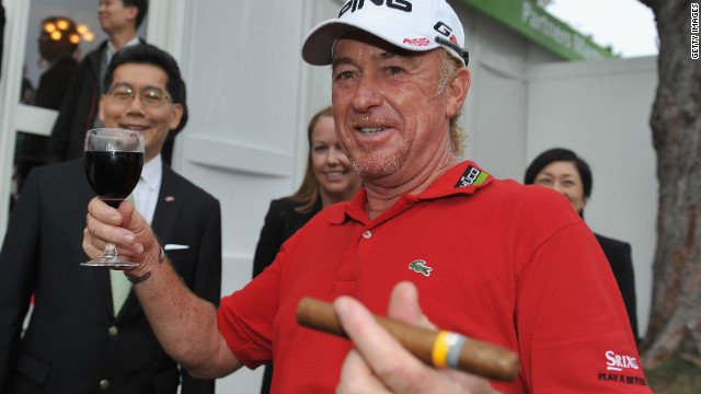 Miguel Angel Jimenez celebrates with a glass of red wine and a cigar after becoming the European Tour's oldest winner with victory at the age of 48 in November's Hong Kong Open.