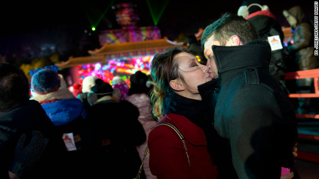 Two revellers kiss as they celebrate the new year during a countdown event at the Summer Palace in Beijing.