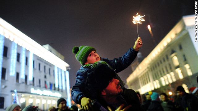 A man and his son celebrate the new year at Alexander of Battenberg Square in Sofia, Bulgaria, early Tuesday.