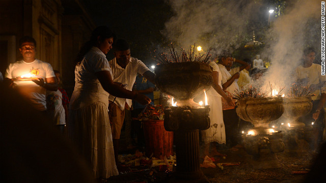 Sri Lankan Buddhists light incense sticks as they offer prayers at the Kelaniya Temple in Kelaniya. Many marked the beginning of 2013 with religious ceremonies.