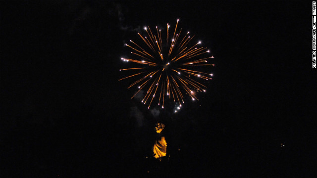 The Cristo del Picacho monument is iluminated by fireworks on New Year's Eve in Tegucigalpa, Honduras.