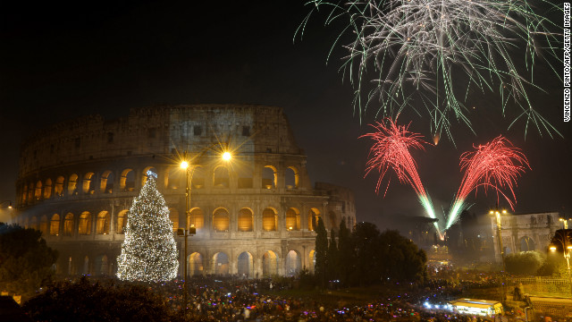 Fireworks light up the ancient Colosseum in central Rome's Via dei Fori just after midnight on January 1.