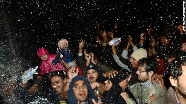 Pakistani youths celebrate the new year on a street in Lahore early Tuesday.