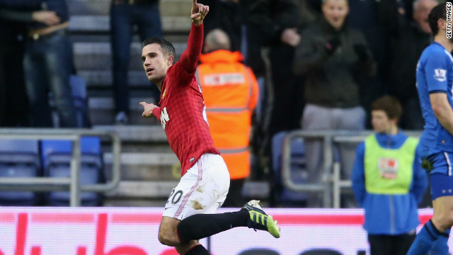 Robin van Persie wheels away after scoring Manchester United's second goal in the 4-0 win over Wigan.