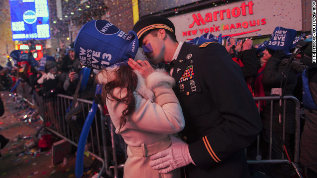 National Guardsman John Cebak kisses his fiancee, Sonja Babic, at the start of the new year in New York's Times Square.