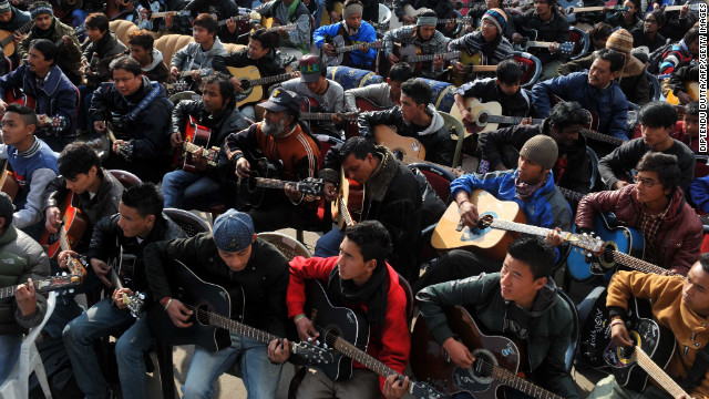 "About 600 guitarists play John Lennon's ""Imagine"" in a tribute to the rape victim in Darjeeling on January 3."