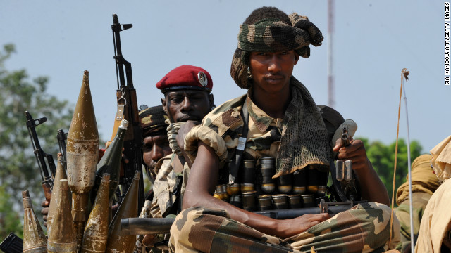 Chadian soldiers, part of a convoy of the FOMAC multinational force of central African states, near Damara on January 2, 2013.
