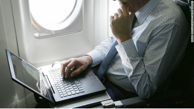 Debate continues over electronic gadgets on planes