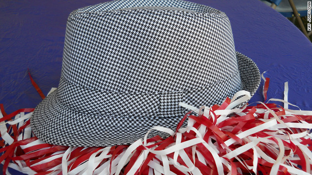 'Bama's signature headgear is the houndstooth fedora. Legendary head coach Paul &quot;Bear&quot; Bryant famously sported one, and fans have followed suit ever since.