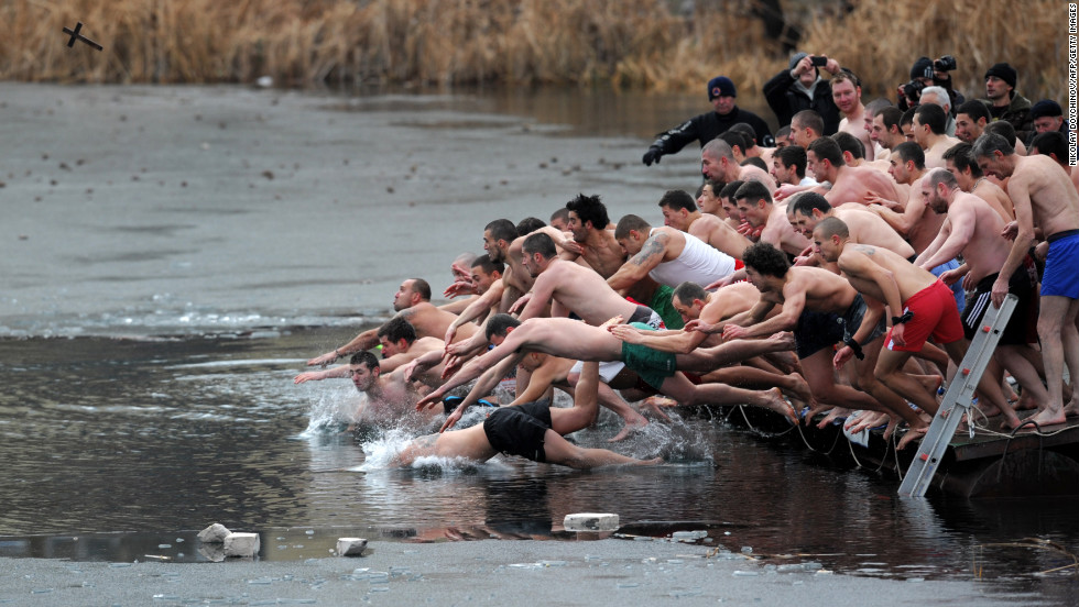 People dive into icy water as they compete to grab a cross in the middle of a lake as part of Epiphany celebrations on Sunday, January 6, in Sofia, Bulgaria. It is believed that the first person to grab the cross, thrown into the water by an Eastern Orthodox priest, will be healthy throughout the following year. The feast day celebrates the revelation of God in human form as Jesus Christ.