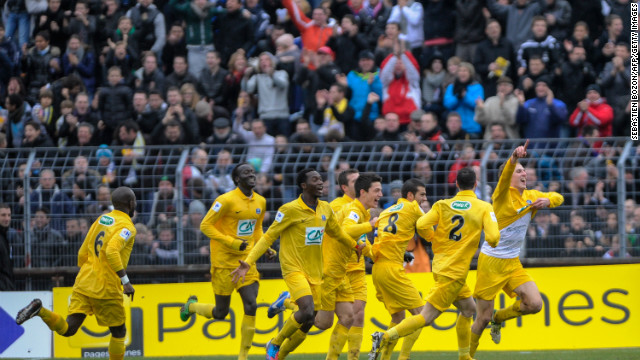 Epinal's French midfielder Tristan Boubaya races away to celebrate after netting against the giant of Lyon. Boubaya scored twice to give his side a 2-0 lead before Bafetembi Gomis and Gueida Fofana brought the visitor level.