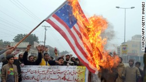 Demonstrators burn a U.S. flag during a protest in Multan on January 3, 2013, against drone attacks in Pakistan\'s tribal areas.
