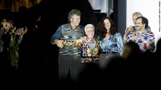 From left: Vittorio, Rosita (his mother), Angela (his sister), Ottavio (his father) and Luca (his brother) acknowledge applause on the catwalk at the end of the Missoni collection during the last day of Milan's 2004 spring/summer fashion week on October 5, 2003. The show marked 50 years since the company was founded by Ottavio (nicknamed &quot;Tai &quot;) and Rosita and 50 years since they married. Vittorio Missoni and his siblings took over the brand in 1996.