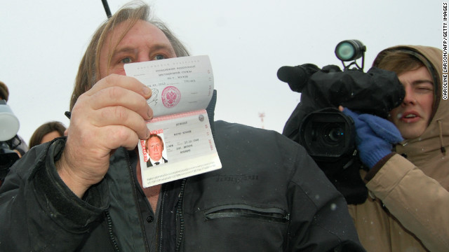 French actor Gerard Depardieu shows off his new Russian passport on January 6, 2013.
