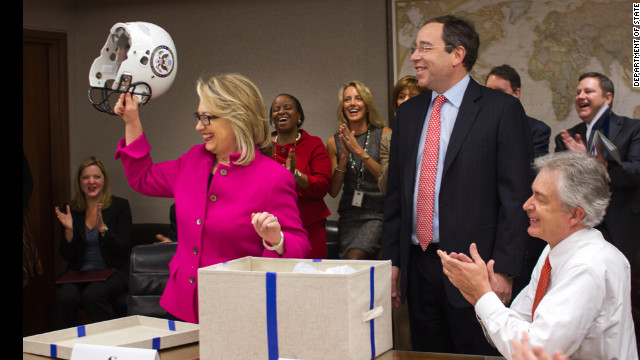 Hillary Clinton back at work - with a football helmet