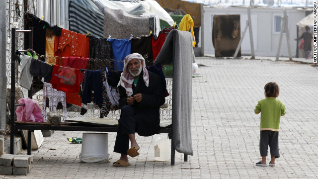 A man whiles away the time in Container City on December 24.
