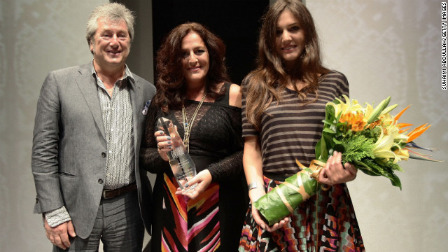 Vittorio, his sister Angela and her daughter Margherita accept an award on the catwalk after their show during the Audi Fashion Festival in Singapore on May 13, 2011.