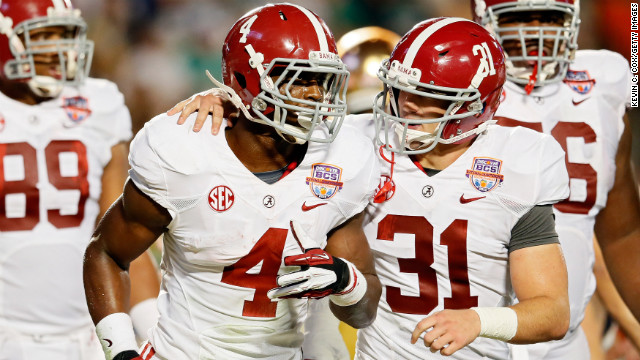 T.J. Yeldon, left, of Alabama celebrates a touchdown with teammate Kelly Johnson.