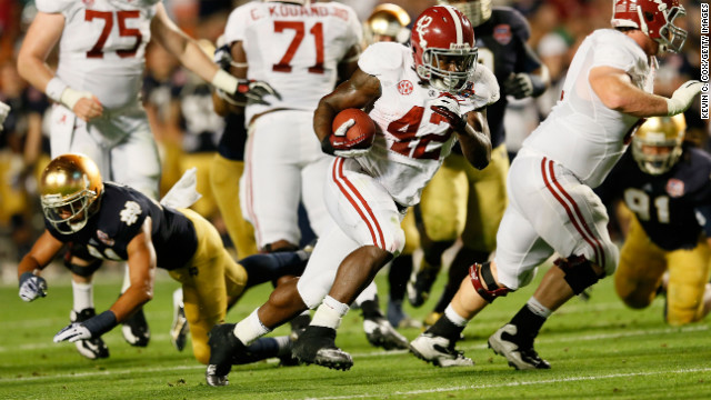 Alabama running back Eddie Lacy carries the ball against Notre Dame on Monday.